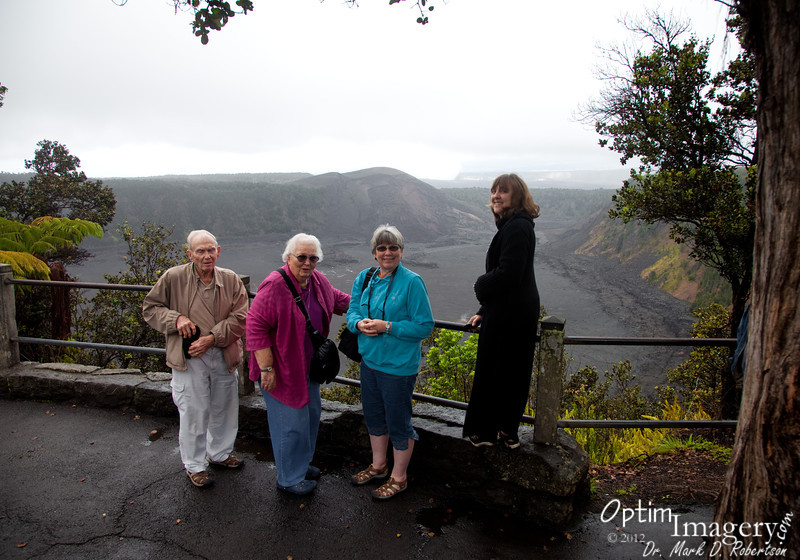 On the rim of Kilauea Iki.  You can see the steam from  Halema`uma`u pit crater in the background.  Jaggar Museum and Visitor Center would be somewhere to your left from Bev's head on the far rim.