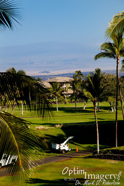 This was the view from our balcony at the Waikoloa Hilton.  The tall peak you see through the vog is Mauna Kea.  See the little white dots on top of it?  Those are the telescopes of Mauna Kea, including some of the largest and most sophisticated in the world.