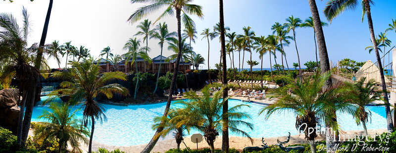 The OTHER end of the resort (south) has this huge pool with waterfall and waterslide.  This is a 14-photo panorama looking down on the central section of the pool.  Notice Bev on the suspension bridge to your right.