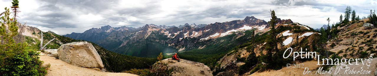 """This is a 20-photo, 180-degree panorama looking down onto Cutthroat Lake.  If you want to see detail, hover your cursor over the photo and then click on """"Original"""" in the pop-out menu.  That will open a full-size photo on your screen (it will be much larger than your screen, so you will need to move around using the navigation bars which will appear to your right and along the bottom of your screen).  To return to the SmugMug album format, just click on the photo."""