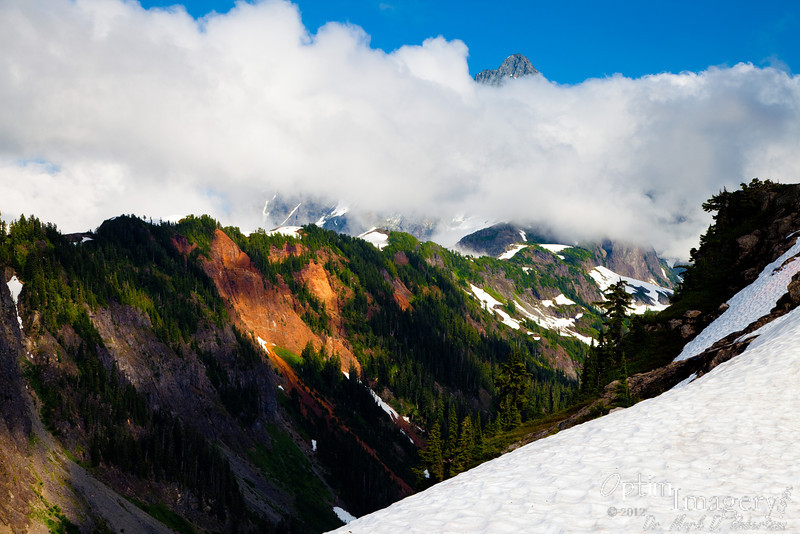 I liked the colorful cliff.  As you can see, clouds are increasing around Mt. Shuksan (while you can't see it in this photo, they are increasing around Mt. Baker, too -- so we decided that Mt. Baker was not going to show herself).  Time to head down.