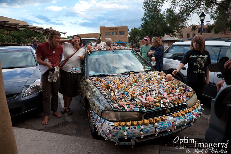 """In Taos this car was attracting lots of attention:  Thousands of things related to teeth (and other odds and ends) glued to the surface.  You can get a closer look by hovering your cursor over the photo and clicking on """"original"""" in the pop-out menu.  Then use the scroll bars to your right and bottom of your screen to move around the enlarged photo.  To return to this SmugMug format, just click on the enlarged photo.  Oh, and remember to floss!"""