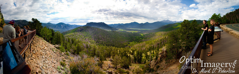 "16-panel panorama from a little further up Trail Ridge Road, looking east.  Keep in mind that the railing you see on each side really makes a nearly straight line in front of me, so the lady on your left is not really taking a photo of Bev and Bri.  Such is the nature of panoramas.<br /> <br /> If you bring it up to original size and look around a bit, you will see considerable detail herein.  To do that, hover your cursor over the photo and click ""Original"" on the pop-out menu.  Then use the scroll bar to your left and bottom of your screen to navigate around.  You'll notice some distortions -- for instance, Bev's back appears to be cut off by an interpretive sign.  Again, such is the nature of panoramas."