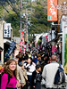 We left the Philosopher's Trail for a bit, and headed through this quaint and very busy village in northeast Kyoto, on our way to Ginkaku-ji, or the Temple of the Silver Pavilion. I like the lady just beyond (and to your right from) Bev in the white sweater holding a camera and quite passionately eating....something.