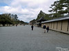 """Japan's first Imperial Palace was built on or near these grounds in 794. Several fires through the ensuing centuries leveled palaces, which were re-built. The current Kyoto Imperial Palace, located behind the wall to your LEFT in this photo, was built in 1855. While the """"real"""" Imperial Palace of Japan is now in Tokyo, official state ceremonies and enthronement of new emperors still take place here. There is a lesser palace of some sort behind the wall to your right. I did not realize that to see inside these walls, one must ask for an invitation. Apparently it is no big deal, and it is my understanding that tourists are routinely granted such invitations, but it takes time, and we decided to be content seeing the walls and moving on to other parts of town."""