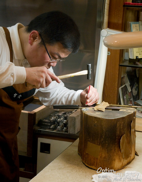 I never quite figured out what this fellow was doing, but I think he was doing some type of fine repair work on a very up-scale knife. I assumed that patrons brought their own knives in to be sharpened and reconditioned.