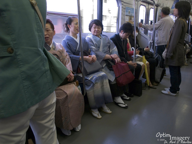 Gee, Toto, from the looks of these women on this train, I don't think we are in Kansas anymore. On the train from Narita City to Tokyo Station.