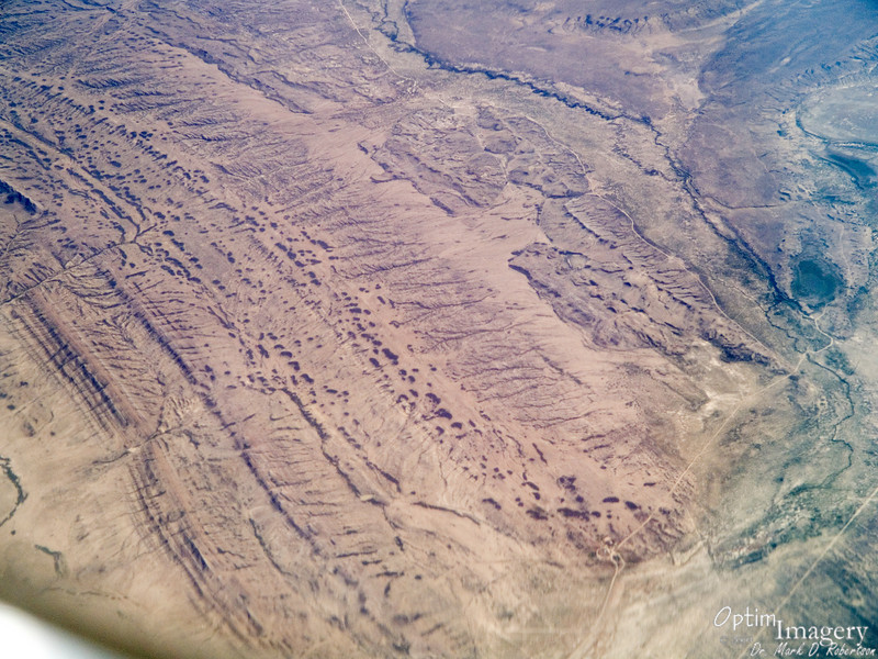 This is one of the few flights I have taken over the U.S. where I really had very little idea where we were at any particular time.  So, this is someplace about half way between Denver and Seattle.  I thought all the sandstone holes and drainage channels looked pretty cool.  Anyone recognize this area?  If so, please leave comments!