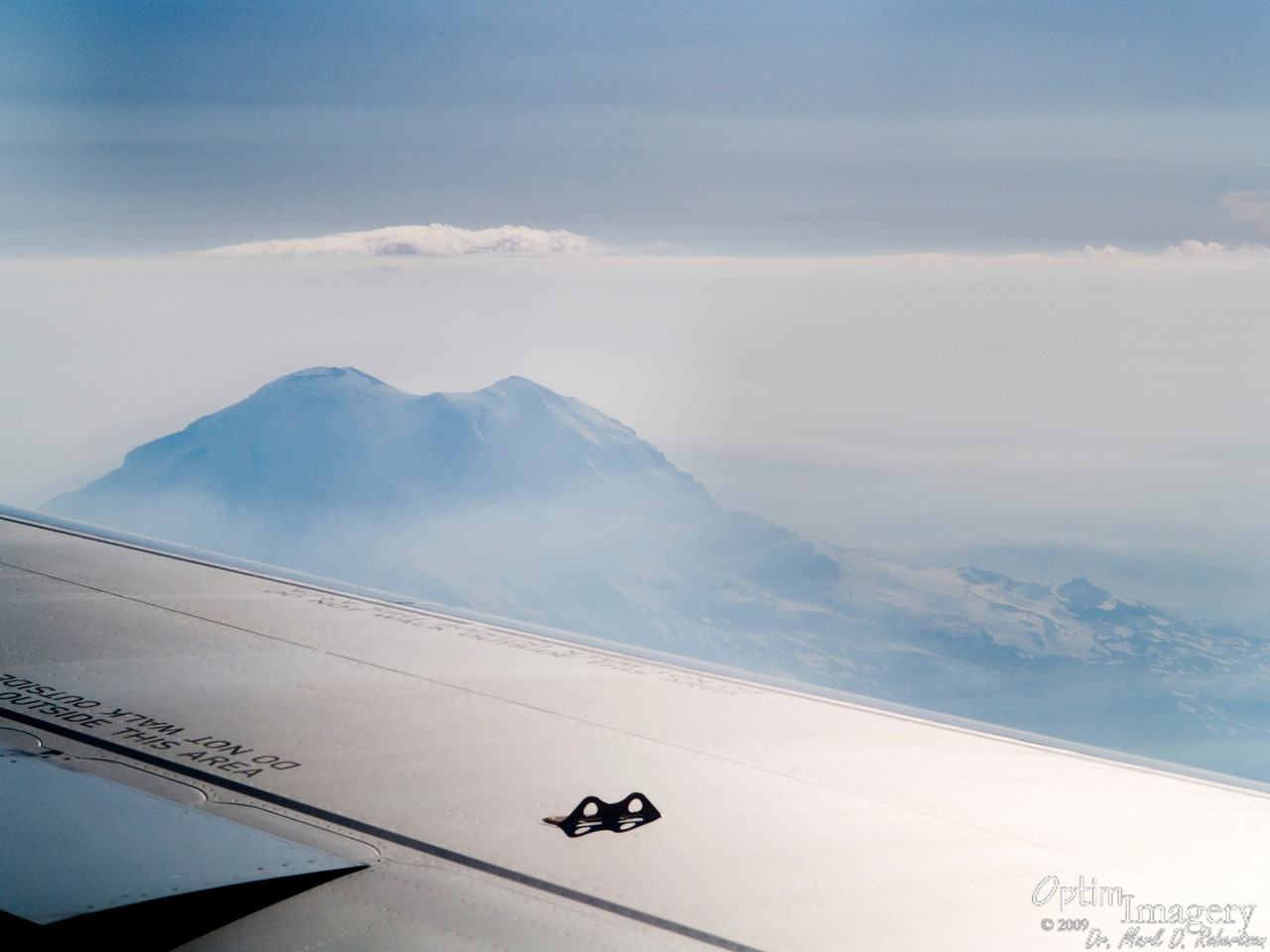 It's always a good omen when Mt. Rainier decides to peek out of the fog and welcome a traveler to the Pacific Northwest.