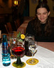 "Dinner time! I'll have to defer to Bri and Bev to remind me what we had to eat. The blue bottle is mineral water. The red is German wine. To the right is ""non-gas"" water, as they call non-carbonated water. Next row has a dark and light Bavarian beer, just in front of the nice flower. I think even Bri may have been satisfied with the arrangement. Right, Bri?"