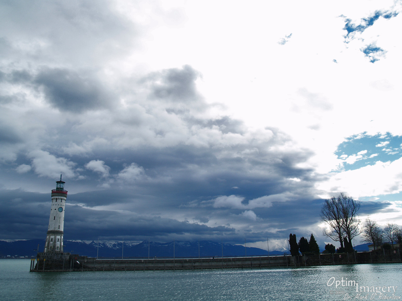 A newer lighthouse, completed about the same time as the harbor. Across the Bodensee you see the Alps of Austria and Switzerland.