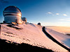 """We are looking south now, with the sun going down to our right.  The closest observatory is the Frederick C. Gillett Gemini Telescope (Gemini North).  More on it later.  Next is the University of Hawaii 2.2 Meter Telescope  ( <a href=""""http://ifa.hawaii.edu/88inch/"""">http://ifa.hawaii.edu/88inch/</a> ), which was the first large observatory built up here (in 1970).  Its 88 inch (7 1/3 feet) mirror is about the same size as is that of the Hubble Telescope.  It observes light in the ultraviolet, visible, and near-infrared regions.  The last one you can see is the United Kingdom InfraRed Telescope (UKIRT).  It's mirror, at 12.5 feet, is the world's largest dedicated solely to infrared astronomy ( <a href=""""http://outreach.jach.hawaii.edu/articles/aboutukirt/"""">http://outreach.jach.hawaii.edu/articles/aboutukirt/</a> )."""