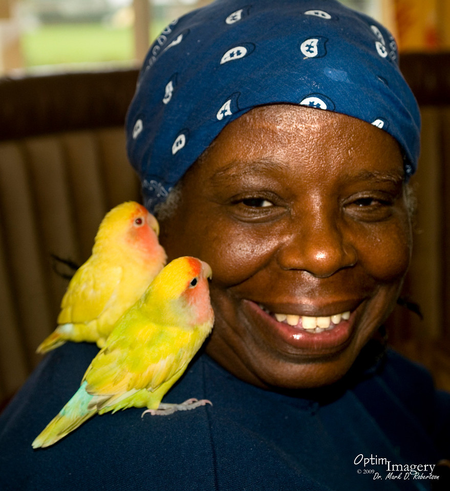 """As Bev and I entered a little general store in Honomu, this lady saw my camera and exclaimed """"He's got a camera!  He can take my picture!""""  These were not her birds, but she had a little time to enjoy them because their owner had brought them in.  Her name is Brenda.  She has had to wait a lllooonnnnggg time for me to get these photos out."""
