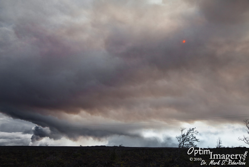 We are several miles west of Kilauea.  Pele is blowing off lots of steam.  That red-orange dot, believe it or not, is the sun.