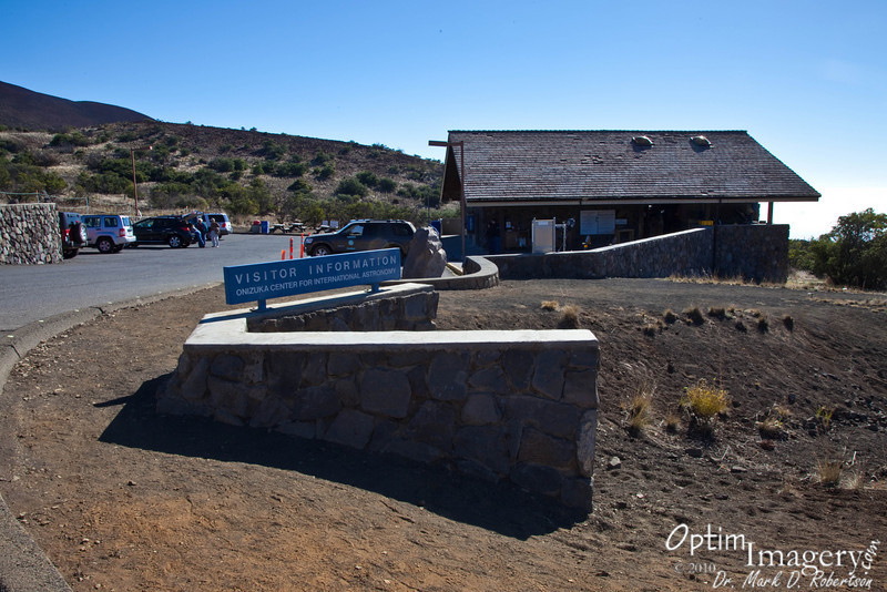 """Located at 9,300 feet elevation, the Visitor Information building of the Onizuka Center for International Astronomy gives a nice place to stretch your legs, use the restroom, and become acclimated to the decreased oxygen level at altitude.  People say that spending an hour here on the way up greatly reduces the chances of altitude sickness on up at the top (elevation 13,600 feet).  There is also a little gift shop and, as the name implies, some interesting and informative displays are here.<br /> <br /> Take a look at the location on a a zoom-able map by pressing """"Map This"""" above.<br /> <br /> And, for more information, look at     <a href=""""http://www.ifa.hawaii.edu/info/vis/"""">http://www.ifa.hawaii.edu/info/vis/</a>"""