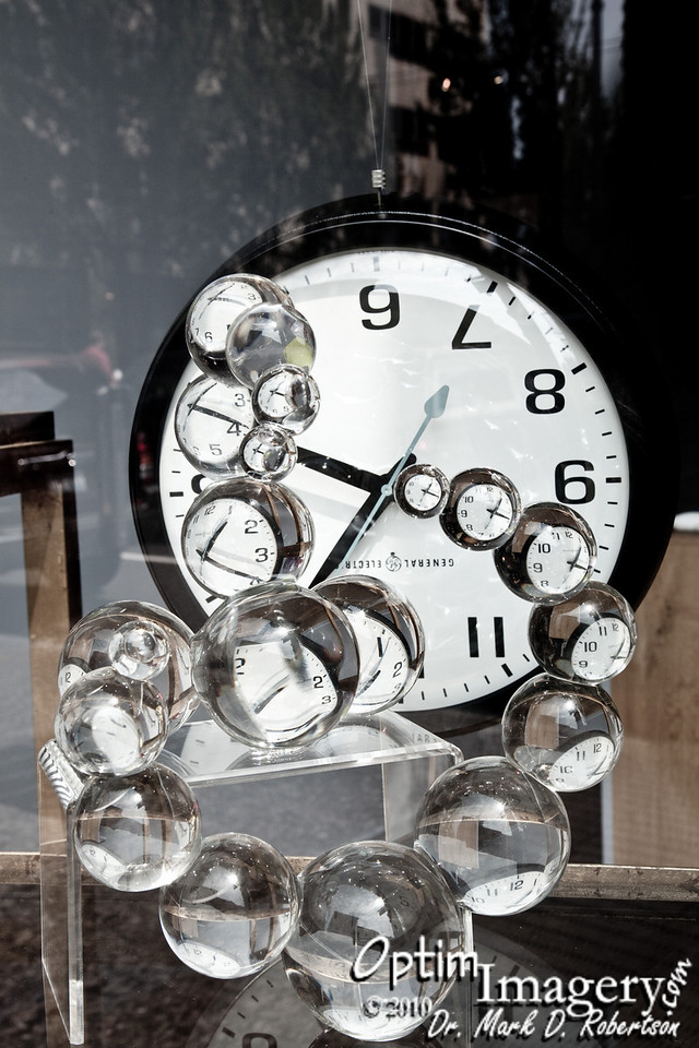 Unique clock assembly in a downtown Seattle gallery.  Notice that the clock is upside down, but that the image is right-side up in all of the glass balls.
