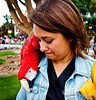 The parrot was fascinated by Olga's pocket button.