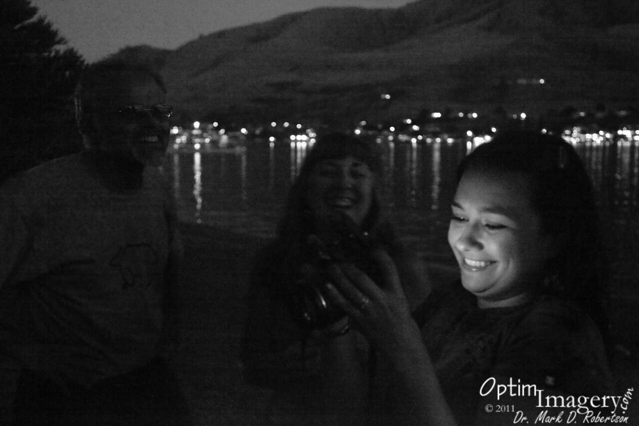 Reviewing photos on the shores of Lake Chelan at Don Morse Park.