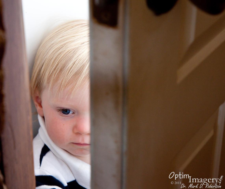 Taylor's favorite hiding place:  Between the main door and the screen door.