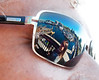 Olga and inner harbor (and M.V. Coho) reflected in Mario's sunglasses.