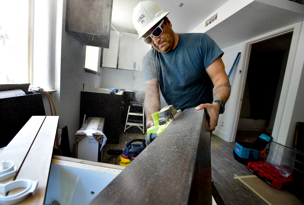 . Isidoro Almaguer of Tharp Cabinets works at one of Thistle\'s affordable housing units under renovation on 20th Street in Boulder on Thursday.  For more photos go to dailycamera.com Paul Aiken Staff Photographer June 14, 2018