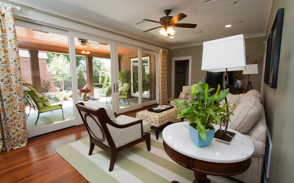The informal family room includes a wall of sliding doors that lead to the deck.
