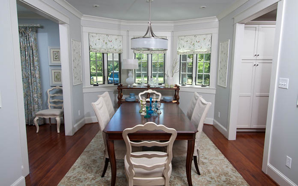 The dining room sits between the expanded kitchen and updated front formal living room.