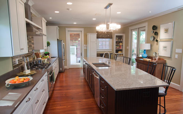 In the kitchen, the team brought in a more modern theme to the home by adding in different colored cabinets and countertop for the kitchen island.