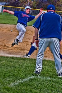Jeremy Hoflock slides into third base