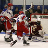 Tewksbury Memorial High School hockey player Stephen Johnson fires the puck past Concord Carlisle High School's goalie Aiden Campbell for their second goal of the game. SUN/JOHN LOVE