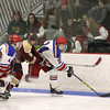 Concord Carlisle High School hockey player Charlie Cook tries to stop Tewksbury Memorial High School player Jonathan fowler from getting the puck during action in their match up on Monday night. SUN/JOHN LOVE