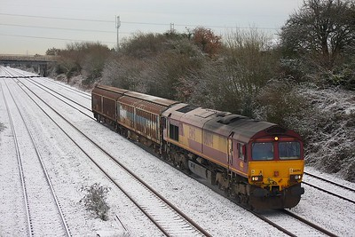 66094 with two cargo wagons passes Bishton westbound on the 21st December 2009