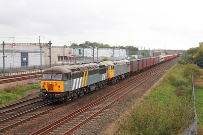 56301+56081 on the 6X89 Dollands Moor to Clapham yard with 707029+707028 at Sevington on the 14 October 2017