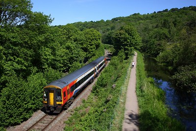 EMR 158777 working the 2N35 1137 Matlock to Newark Castle departs Whatstandwell on the Matlock line in the Derwent valley on 29 May 2020