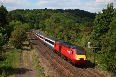 EMR ex-LNER 43238 leads 43318 on 1C61 1425 Leeds to London St Pancras via Barnsley exiting Milford Tunnel at Duffield on the Derwent Valley line on 31 May 2020