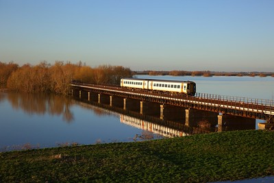 158774 on the 1L09 1243 Sheffield to Norwich crosses the Hundred foot drain - Ouse Washes at Pymoor south of Manea on the 19th January 2020