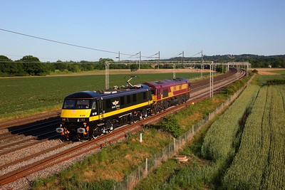 DB Cargo Grand Central 90026 leads 66187 on 0G77 Wembley to Crewe at Grendon on WCML on 29 May 2020