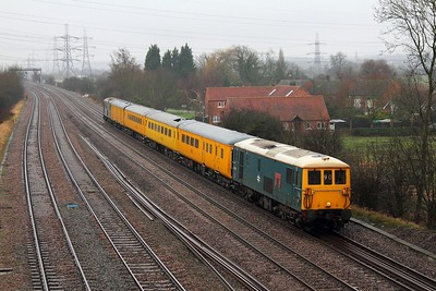 73201 'Broadlands' formerly 73142 leads Two Tone Grey liveried 73107 'Redhill 1884-1994' are captured on the Midland Mainline at Ratcliffe on Soar near East Midlands Parkway on the main, top-and-tailing the 1Q50 10:00 Ferme Park to Derby RTC test train consisting of 9523, 977983, 999550 and 6261 and running almost 100 minutes early on the 9th February 2013