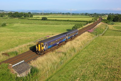 156467 working 1N56 0741 Dumfries to Newcastle at Warrenhill, Greenlea on 24 July 2021  Class156, Scotrail, GSW,