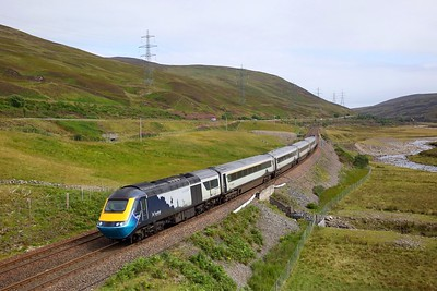 43145 leads 43129 both with face masks applied, on 1H51 1209 Glasgow Queen Street to Inverness at Dalnaspidal a few miles south of Dalwhinnie on 10 August 2020  Scotrail, ScotrailHSTs, HML