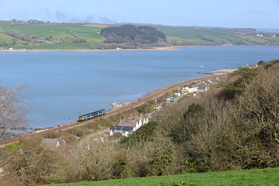 150250 working 1B96 Swansea to Fishguard Harbour at Ferryside on 3 April 2021  Class150, TFW, WestWalesline