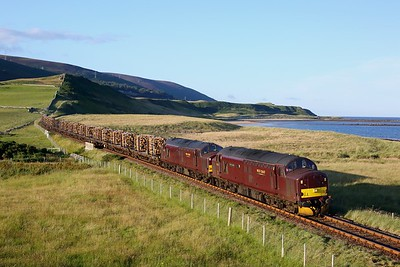 37516 leads 37669 on 6Z69 Georgemas junction to Inverness loaded timber at Lothmore on 8 August 2020