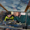 Rosalie Dunbar, owner of  Top Fun Aviation Toy Museum in Fitchburg, shows Aiden Howard, 7, of Schituate, toy planes displayed in a glass case on Saturday Feb. 5, 2017.  Sun photo/Jeff Porter