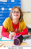 Un16.16 / New photo requested of child with down syndrome in classroom setting, choice 11 of 13