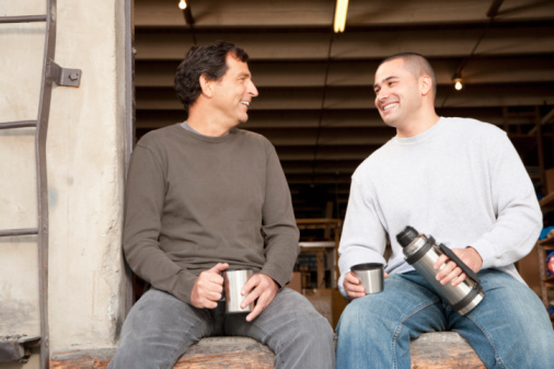 Un15.10b / Two male co-workers talking at the office / How is adult friendship different among female friends, male friends and cross-gender friends.  Choice 2 of 14