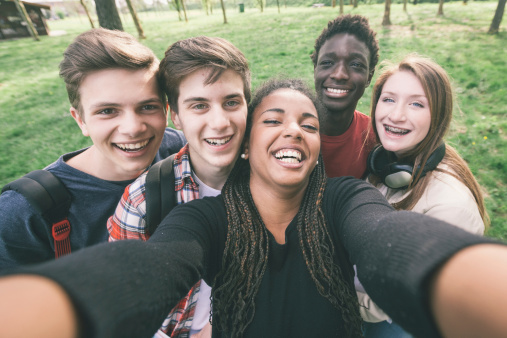 CO15.1 / Diverse group of adolescents showing positive emotion. Choice  5 of 21