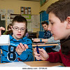 Un16.16 / New photo requested of child with down syndrome in classroom setting, choice 9 of 13