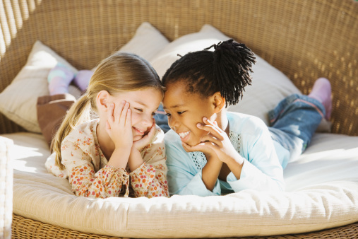 un15.09 / New photo requested of girls talking privately together / what characterizes children's friendships.  Choice  4 of 17