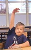 Un16.16 / New photo requested of child with down syndrome in classroom setting, choice 13 of 13