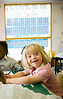 Un16.16 / New photo requested of child with down syndrome in classroom setting, choice 2 of 13